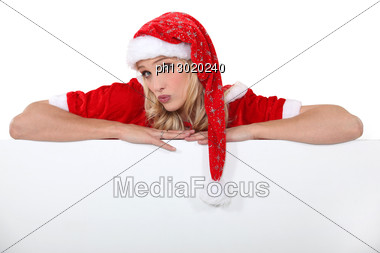 Woman In Festive Outfit Stood With Poster Stock Photo