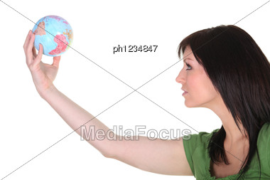 Woman In Green Reaching Out To The World Stock Photo