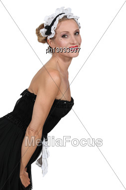 Woman In Maidservant Costume Stock Photo