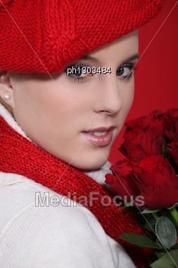 Woman In A Red Beret With Red Roses Stock Photo