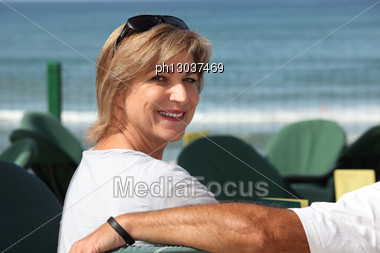 Woman In Seaside Cafe Stock Photo