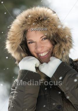 Woman In Winter Coat & Hood Stock Photo