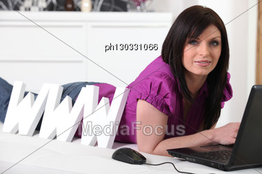 Woman Laying By Letters Stock Photo