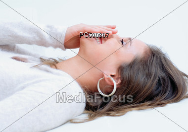 Woman Laying on Back Laughing Stock Photo