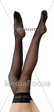 Woman's Legs Covered In Stockings Stock Photo