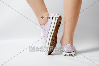 Woman Legs On White Pink Gumshoes On Back View Closeup Stock Photo