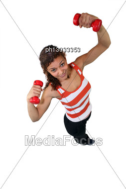 Woman Lifting Weights Over Head Stock Photo