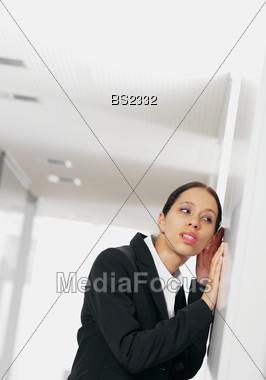 Woman Listening on the Corridor Door Stock Photo