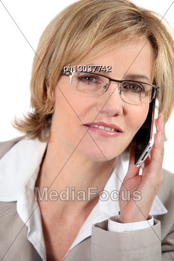 Woman Listening To Her Cellphone Stock Photo