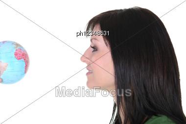 Woman Looking At Globe Stock Photo
