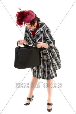 Woman Looking Into Open Handbag Stock Photo