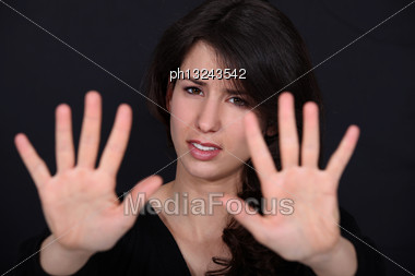 Woman Making A Stop Sign Gesture With Her Hands Stock Photo