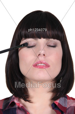 Woman Making Up Her Eyes Stock Photo