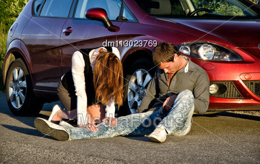 Woman And Man On A Road. Concept Car Accident Stock Photo