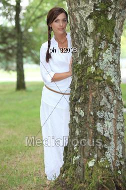 Woman Next To A Tree Stock Photo