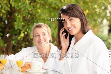 Woman On A Mobile Phone At Breakfast Stock Photo