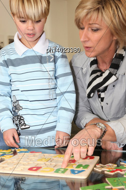 Woman Playing With Her Grandson Stock Photo