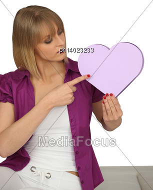 Woman Pointing To A Heart-shaped Box Stock Photo