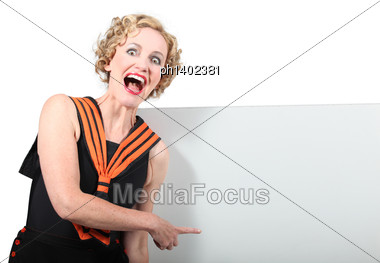 Woman Pointing To A Panel Stock Photo