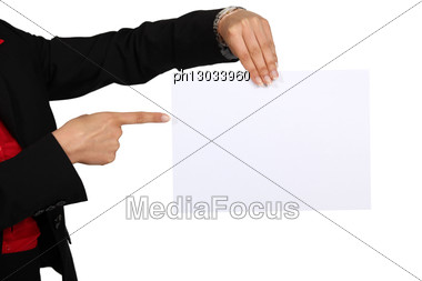 Woman Pointing To Blank Poster Stock Photo