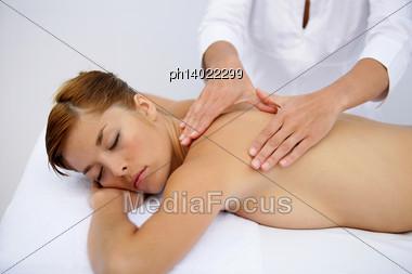 Woman Receiving Back Massage Stock Photo