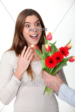 Woman Receiving Bouquet Of Flowers Stock Photo