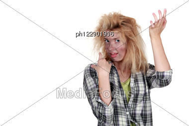 Woman Receiving Electric Shock Stock Photo