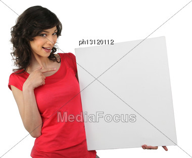 Woman In Red Pointing At A Board Left Blank For Your Message Stock Photo