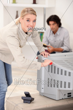 Woman Removing The Back Of A Tv Set Stock Photo