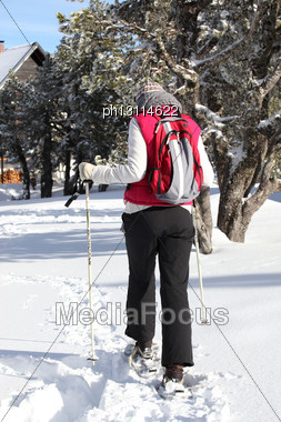 Woman Retuning To Chalet After Cross Country Ski Stock Photo