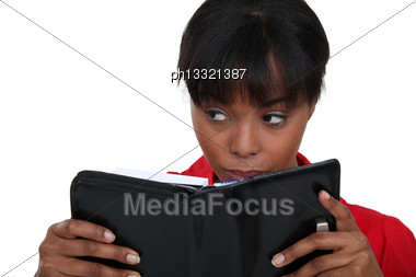 Woman Secretly Reading Diary Stock Photo