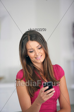 Woman Sending A Text Message Stock Photo