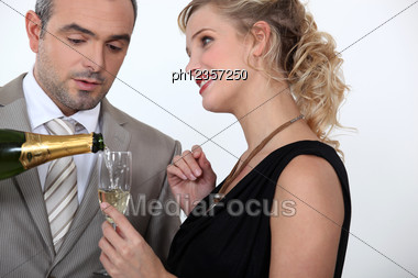 Woman Serving Champagne Stock Photo