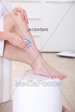 Woman Shaving Her Legs Stock Photo