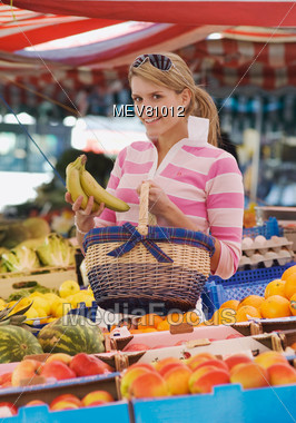 Woman Shopping At Fruit Stand Stock Photo