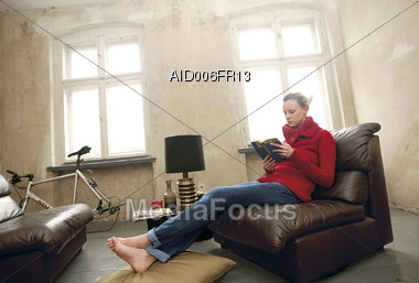 Royalty Free Stock Photo Woman Sitting At Home On Sofa Reading