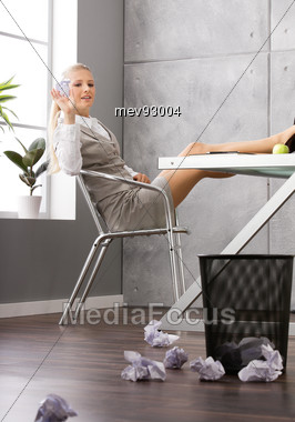 Woman Sitting In The Office, Throwing Paper Trash Stock Photo
