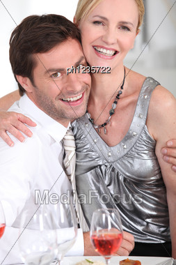 Woman Sitting On A Man's Lap Stock Photo