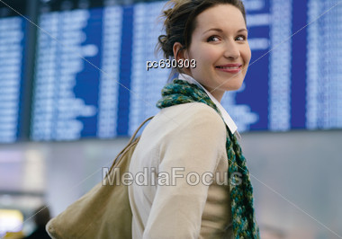 Woman Smiles At The Camera, Munich Airport Stock Photo