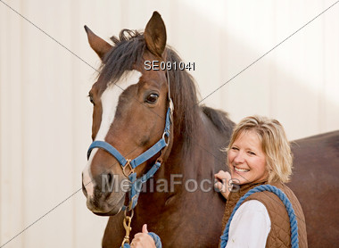 Woman Smiling with her Horse Stock Photo