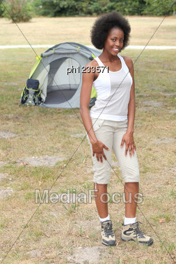 Woman Stood By Her Tent Stock Photo