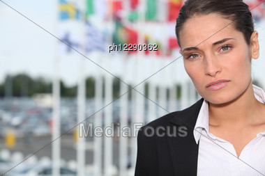 Woman Stood In Front Of Various National Flags Stock Photo
