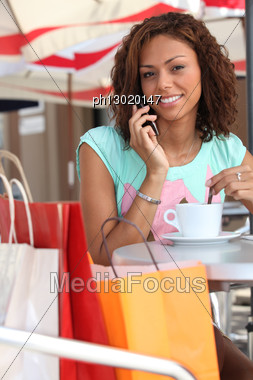 Woman Taking A Break From Shopping Stock Photo
