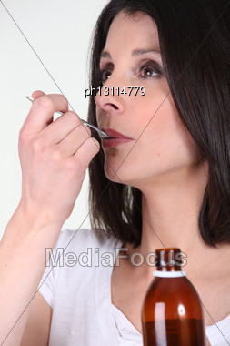 Woman Taking Cough Syrup Stock Photo