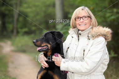 Woman Taking Dog For A Walk Stock Photo