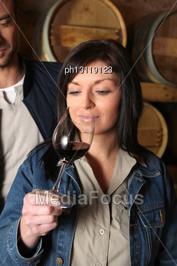 Woman Tasting Glass Of Red Wine Stock Photo