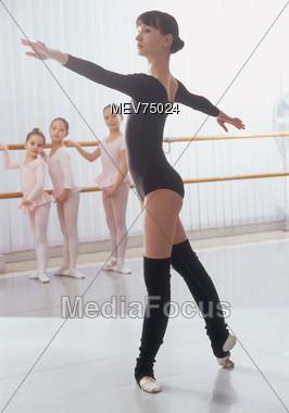 Woman Teaching Ballet to Little Girls Stock Photo