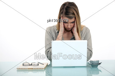 Woman Tired Of Working On Her Laptop Stock Photo
