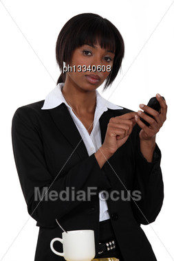 Woman Typing A Messaging On Her Touch Pad Stock Photo