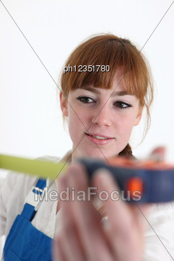 Woman Using A Measuring Tape Stock Photo